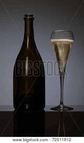 Elegant photo of a champagne flute on dark background.