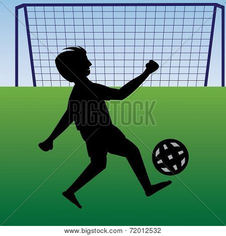 Teen Practicing Football Near The Goalpost