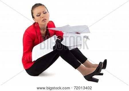 Businesswoman with a pile of papers