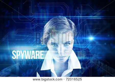 The word spyware and focused businesswoman against blue technology interface with circuit board