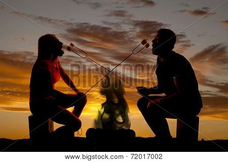 Silhouette Man And Woman With Roasted Marshmallows