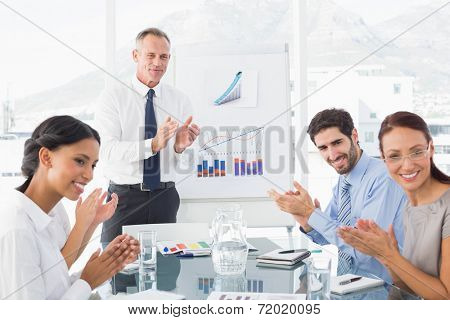 Business people applauding at meeting in work