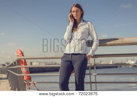 Woman Standing Talking On A Mobile