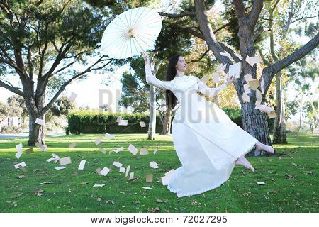 Floating Levitation Girl Outdoors With Book Pages Flying