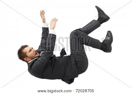 stressed screaming businessman in black suit falling down over white background