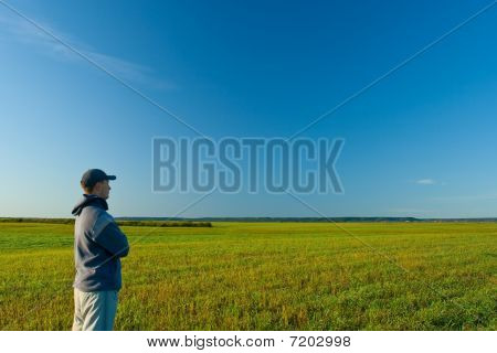 Man Standing On Field