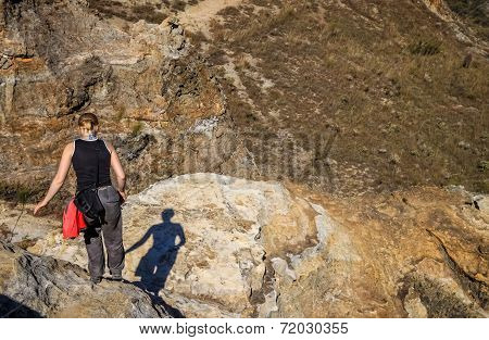 Woman trekking on rocky trail