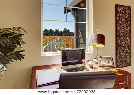 Office Area In Bright Living Room With Window