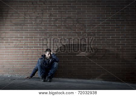Young Desperate Man Who Lost Job Lost In Depression Sitting On Ground Street Corner
