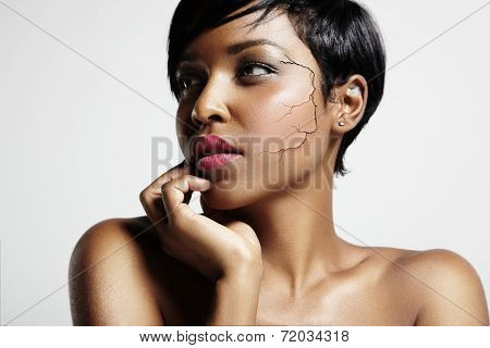 Pretty Black Woman With A Cracked Skin On A Face