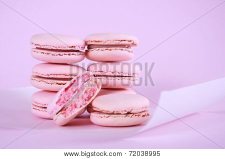 Pink Macarons Petit Fours Cookies Close Up On Pink Background.