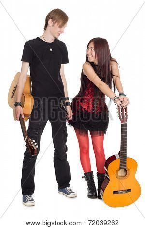 Young musicians with guitars. Interracial young couple, Asian woman and Caucasian man.