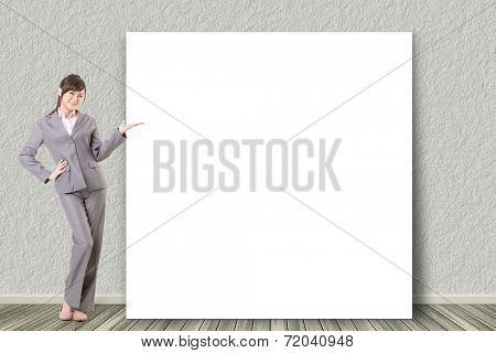 Asian business young woman introduce with blank board in a room.