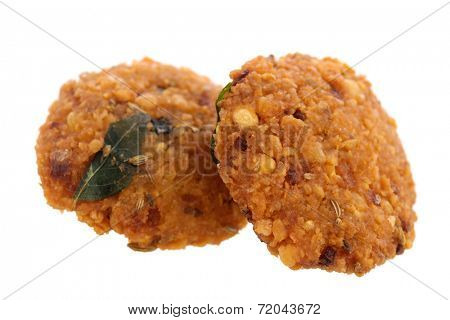 Crispy deep fired vadai snack, common street food in the Indian Subcontinent and Sri Lanka, shoot isolated on white background.