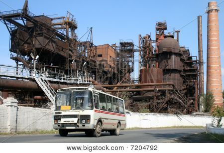 The bus against ancient factory
