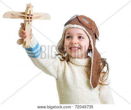 Happy Child Dressed Pilot And Playing With Wooden Airplane Toy