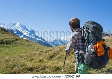 COL DE BALME, FRANCE - SEPTEMBER 01: Backpackers looking at view with Mont Blanc in the background. The area is a stage of the popular Mont Blanc tour. September 01, 2014 in Col de Balme.
