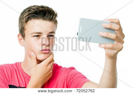 Teen Boy Taking Self Portrait With Smart Phone.