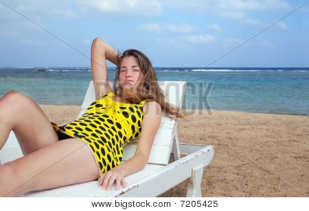 Girl  Relaxing In Deck Chair