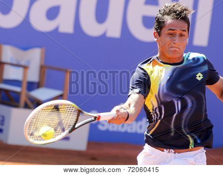BARCELONA - APRIL, 23: Spanish tennis player Nicolas Almagro in action during a match of Barcelona tennis tournament Conde de Godo on April 23, 2014 in Barcelona