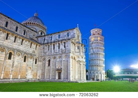 Piazza Del Duomo With Pisa Tower And The Cathedral Illuminated At Night