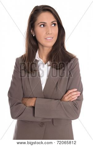 Sceptically isolated business woman in brown blazer looking sideways.