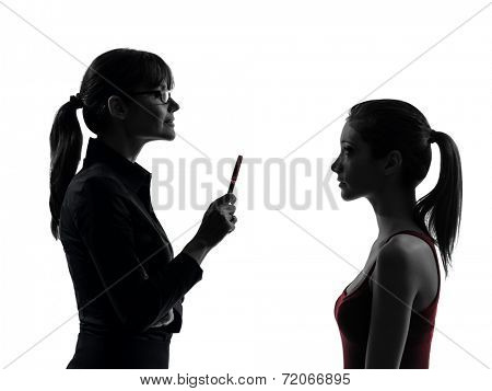 one  teacher woman mother teenager girl discussion in silhouette studio isolated on white background