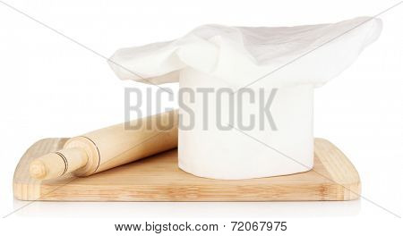 Chef's hat with spoon and battledore isolated on white