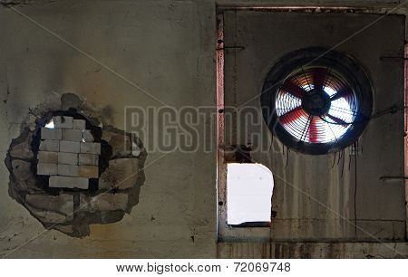 Old Fan In The Wall Of Abandoned Factory