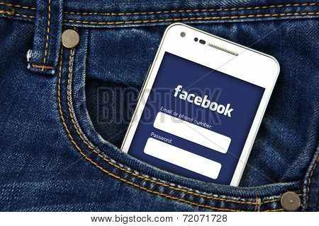 Gdansk -  Poland, September 16, 2014. Smartphone In The Pocket With Facebook Login Page. Facebook Is