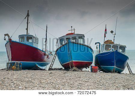 Fishing boats moored on a pebble beach
