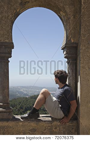 Young Man In Arabian Arch Of  Pena Palace, Sintra