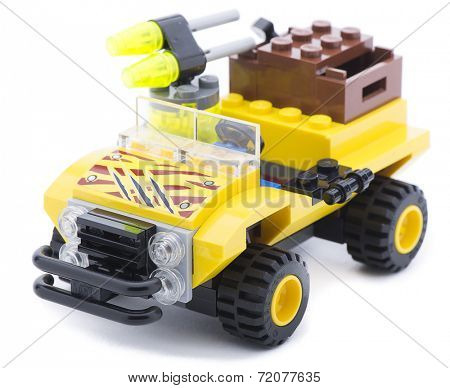Ankara, Turkey - June 21, 2013:  Lego yellow safari car isolated on white background.