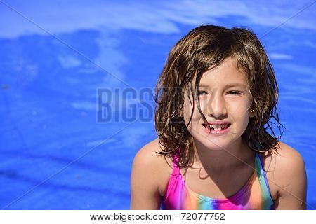 Portrait of a happy kid in the pool with copyspace