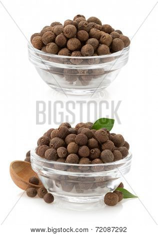 allspice in bowl isolated on white background