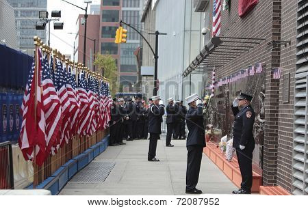 Saluting by FDNY memorial wall