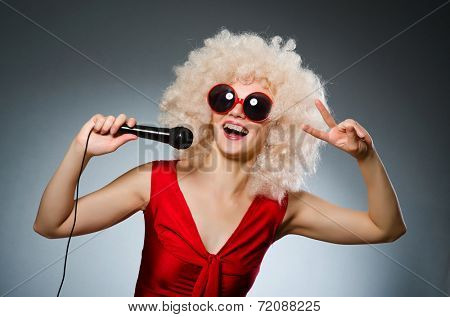 Young woman with mic in music concept