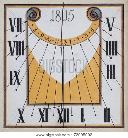 Restored old sundial with mural painting