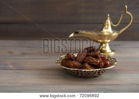 Dates In Golden Bowl And Arabian Lamp