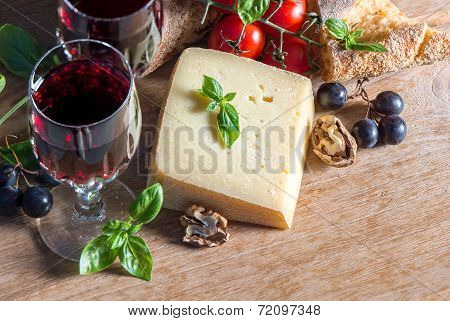 Cheese With Red Wine, Walnuts, Tomatoes, Basil Leaves And Grapes
