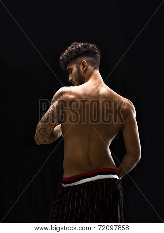 Young Athletic Man With Tattoo Posing Isolated Over Black