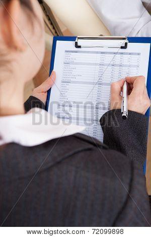 Psychiatrist Writing On Clipboard