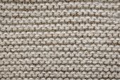 pic of garter  - Knit texture of undyed natural brown alpaca wool knitted fabric with garter stitch pattern as background - JPG