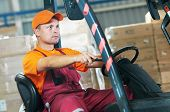 pic of forklift driver  - warehouse worker driver in uniform operating forklift stacker loader - JPG