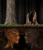 stock photo of pain-tree  - Grief And Grieving concept as two trees with roots shaped as human heads with one dead tree in a forest as a symbol for loss and a metaphor for spirituality in mourning a loved one that has died - JPG