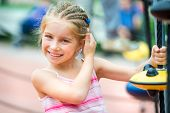 picture of playground school  - cute beautiful smiling little girl on a playground - JPG