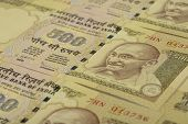 stock photo of indian currency  - High Resolution Close up of Indian Five Hundred Paper Currency - JPG