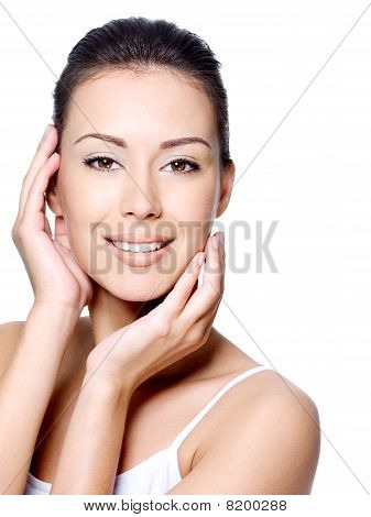 Smiling Woman Stroking Her Beauty Face