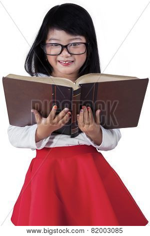 Beautiful Kid With A Book In Studio