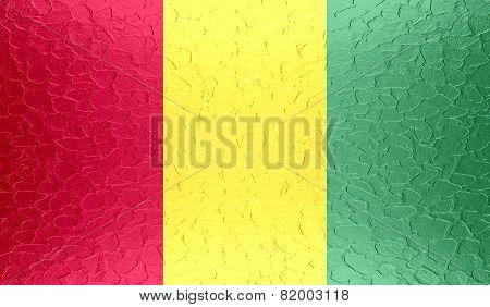 Guinea flag on metallic metal texture